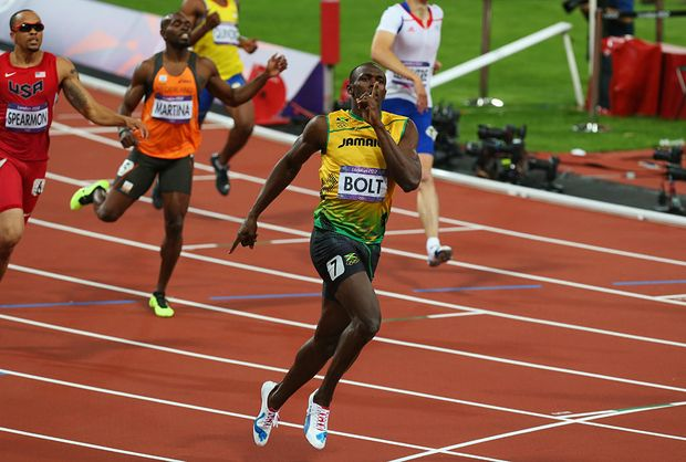 Usain Bolt of Jamaica races to the finish line to win gold ahead of Warren Weir of Jamaica in the Men's 200m Final on Day 13 of the London 2012 Olympic Games at Olympic Stadium on August 9, 2012 in London, England.