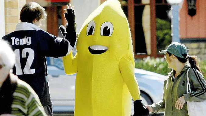 Banana Jim about to get a high five as he walks the street at Murwillumbah.