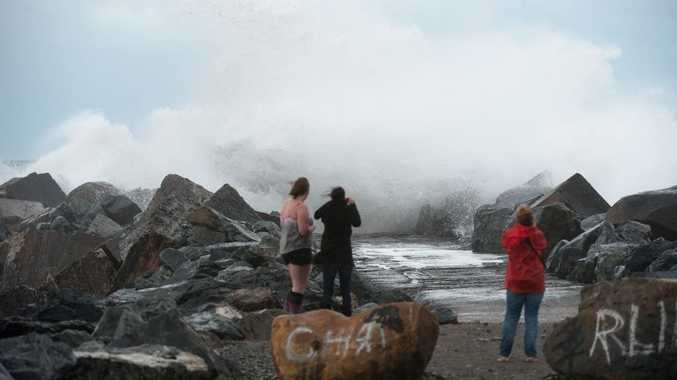 Onlookers at South Wall brave wild seas to get a good photo