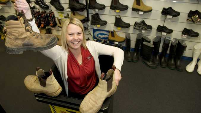 Jo Miller from Totally Workwear shows off some old work boots that need recycling.