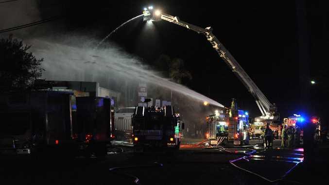 Firefighters battle blaze that broke out at Kawana Wreckers in Production Avenue Warana on Monday night.