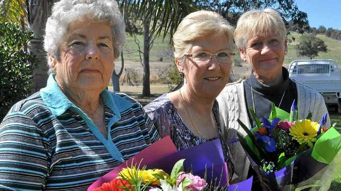 Rita Ridyard (centre) is off to England to begin another chapter of her life. She gave her friend Margaret Buchner (left) and sister Nadine Horneman a bunch of flowers at her farewell.