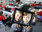 Bethany Lutheran Primary School students Katrina Mibus and Caitlin Alchin enjoy the ipad which has been rolled out to all year 5 and 6 students at the school. Photo: Sarah Harvey