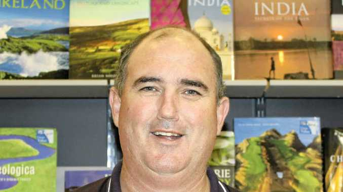 New Clarence River Cricket Association president Tom Howard at his Grafton bookstore.