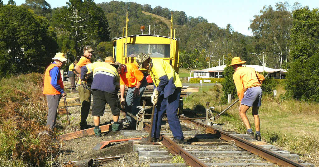 Volunteers work on the Mary Valley line.