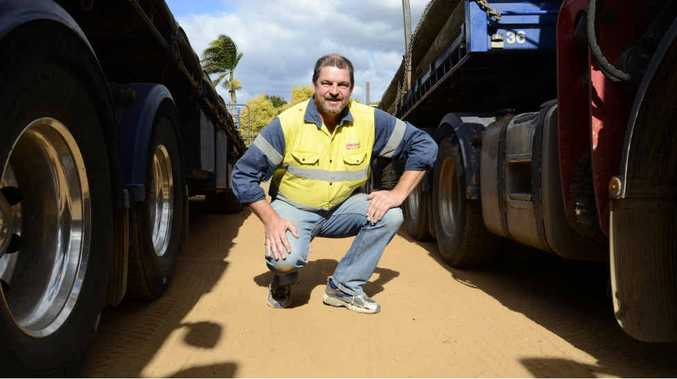 EX-IRONMAN: Christopher Blanchard next to his trucks at the Grafton Blanchard's depot.
