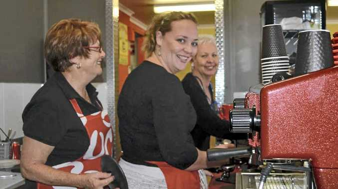 BUSY BARISTAS: Evans Head Bakery owners Helen Aarts (right), Sandra Aarts (middle) and employee Annette Walz were kept busy making coffees at the opening of their new coffee bar.