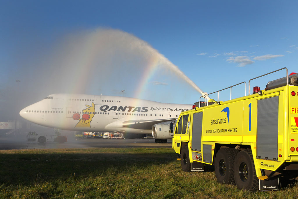 Two of Airservices Aviation Rescue and Fire Fighting Rosenbauer Mk8s at Sydney Airport perform a water arch salute to the Australian Olympic team on their arrival home from the London 2012 Olympics.