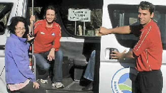 Maggie Clark boards at Tyagarah, helped by Amanda Lucantonio and driver Daniel-John Peterson.
