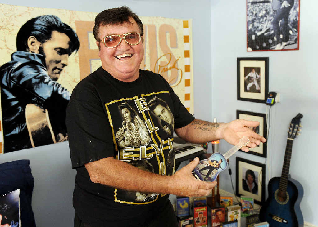 Casino fan John Stevens with some of the items from his Elvis collection.
