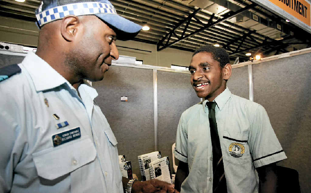 St Brendan's College student Lionel Anau chats with Rockhampton Police officer Richard Monaei about pursuing his career dream of becoming a police officer.