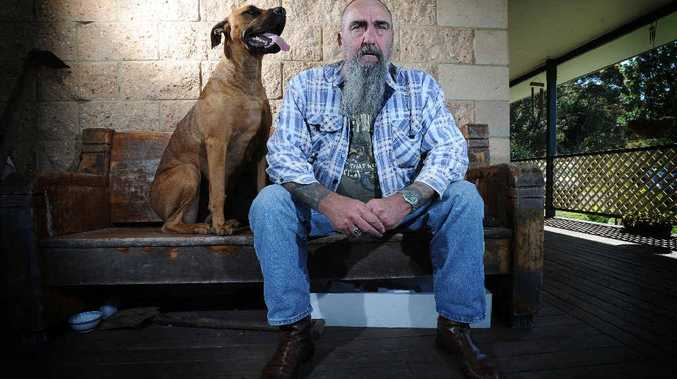Vietnam Veteran Trevor Pleace and his dog Floyd at their Rock Valley property.