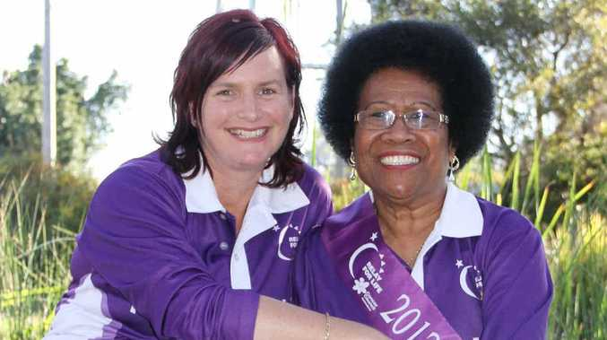 Terri Weatherly and Ula Ganter don their purple Relay for Life shirts.