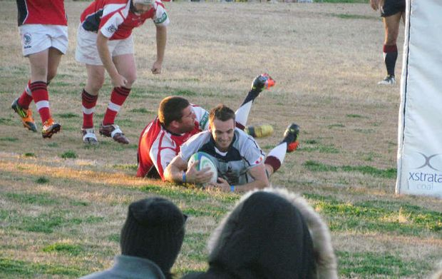 Capella centre Adam Woods runs in another try for the Capella Cattle Dogs at the weekend.