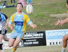 Billy Rogers offloads for the Devils in a recent match against Bribie Island.