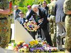 Veteran Danny Matthews lays a wreath at the Bundaberg Vietnam Veterans Day service in Takalvan St.