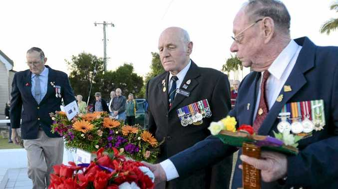 John Stubbs and Bob Fisher lay wreaths at the Maclean RSL Sub-branch Long Tan Day Memorial Service at the Maclean Cenotaph on Saturday.