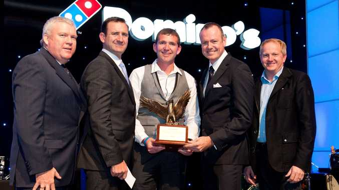 Leroy Day (centre) with his Domino's Pizza Leadership Eagle award.
