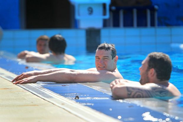 Forward Jason Ryles relaxes with other Melbourne Storm players at a recovery session at the Kawana Aquatic Centre.