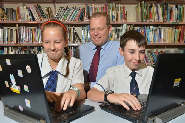 Suncoast Christian College deputy principal Greg Mattiske watches students Emmerson Madden and Kale Medina as they use Netbox Blue CyberSafe-School software.