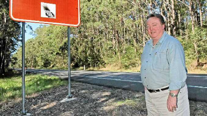 Glen Elmes says these ugly road signs will be removed.