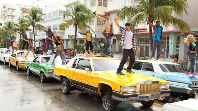 Ryan Guzman (centre, no shirt) in a scene from the movie Step Up 4: Miami Heat.