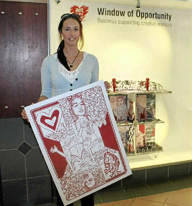 INSPIRED: Nicolle Reeves with her work The Power of Choice that is currently featured in the Star Court Theatre's Window of Opportunity.