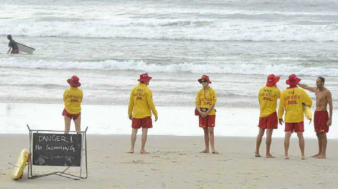 Signs warning of dangerous surf conditions at Main Beach Byron Bay on the last day of the school holidays. Surf lifesavers were warning people to only swim between the flags.