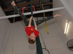 Zac hangs on circus selection