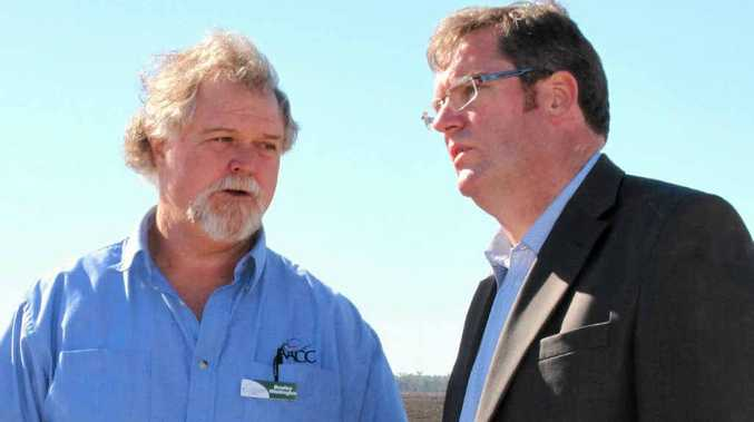 Agriculture Minister John McVeigh talks AgCollege operations with staff member Bradley Whittington.
