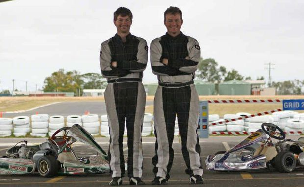 Emerald KZ-2 competitors Ben Finch and Murray Herwin tower over their karts.