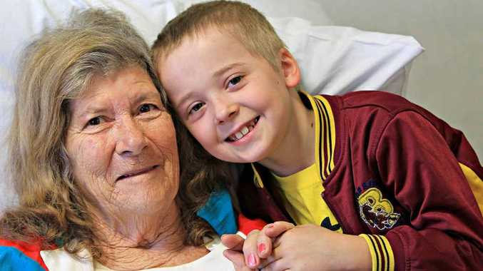Jai Timms, 9, called an ambulance when he found his nana, Marg Clark, lying on the floor and struggling to breathe. He received an award for his bravery.