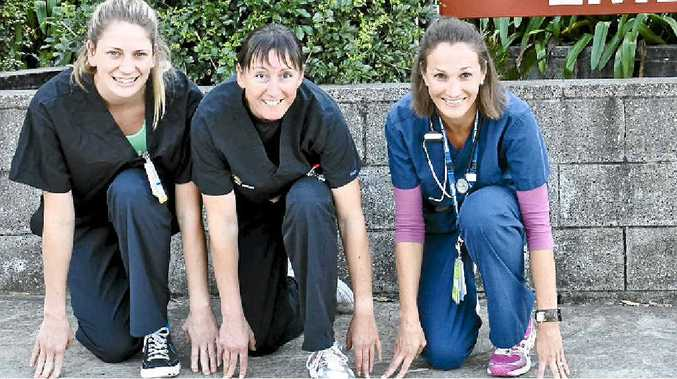 Runners (from left) nurses Ruth Cavill and Jo Bettison, and Dr Tanya Whitley get ready for the Sunshine Coast Marathon.