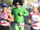 Koppo Kopcikas taking part in the Sunshine Coast Marathon in his signature green lycra suit.