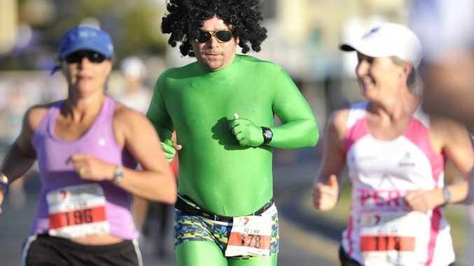 Koppo Kopcikas taking part in the Sunshine Coast Marathon in his signature green lycra suit.