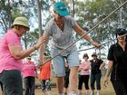 Sally Houghton (centre) makes her way around the low rope section of the course with help from Sandy Panitz (left) and Rosina Greer at the 'face your fears' weekend for cancer survivors.