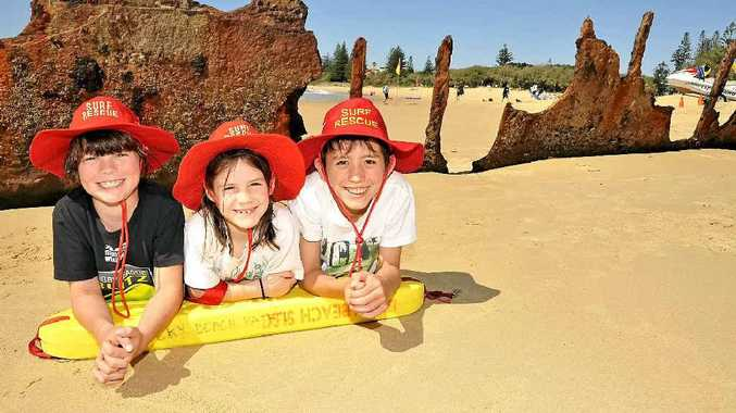 Oliver Barbour, 8, Zara Morris, 7, and Luke Morris, 11, look forward to the official start of the surf life saving season on September 22.