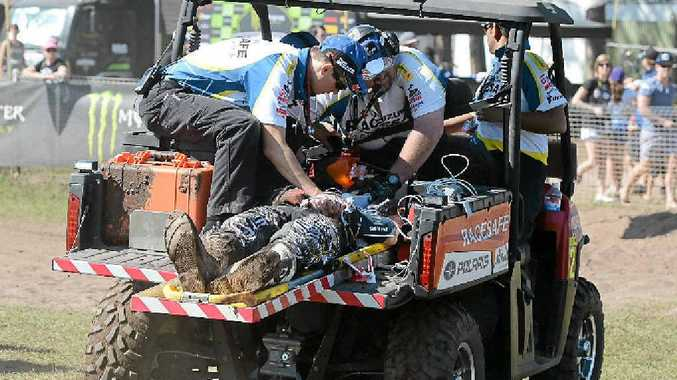 Kirk Gibbs is treated after crashing during the final round of the MX Nationals at Coolum.