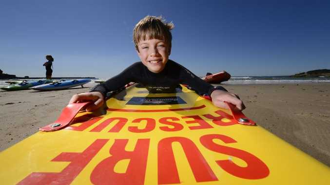 Josh Morris, 9, of Yamba Surf Life Saving Club gets back on the board at the surf club open day on Sunday.