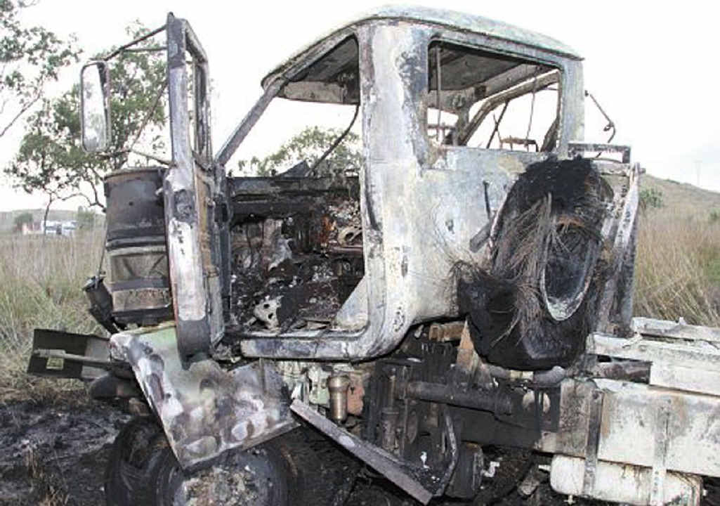 The burnt-out wreck of one truck after the crash on the Bruce Highway near Bajool. A woman died in a B-double.