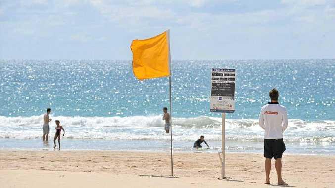 A Sunshine Coast Council lifeguard keeps an eye on swimmers at Mooloolaba Beach.