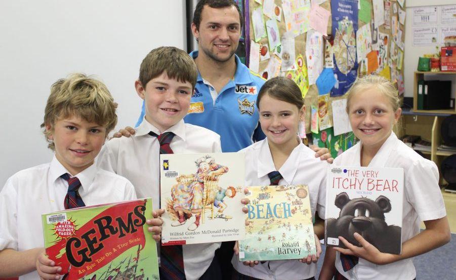 Gold Coast Titans' Sam Mescalle with Lindisfarne Anglican Grammar School students.