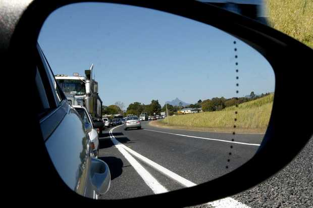 Motorists sit idle as roadworks hold up traffic at Tumbulgum on Tweed Valley Way.