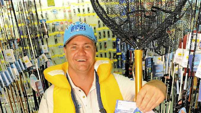 Tackle World sales assistant Brett Robinson with a few popular goodies for Father's Day.
