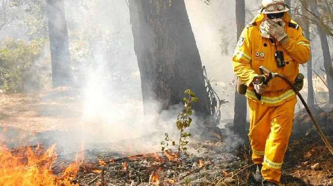 Byron Bay rural Fire Service deputy captain Steve Cullen puts out a blaze.