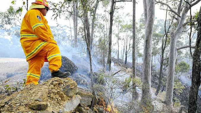 Rural Fire Service volunteers are fighting a blaze on the Far North Coast that has caused the closure of The Tweed Coast Road.