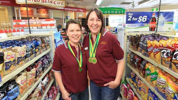 Kylie Rozynski, left, and Karen Atkinson of BP Maroochydore both won customer service medals.