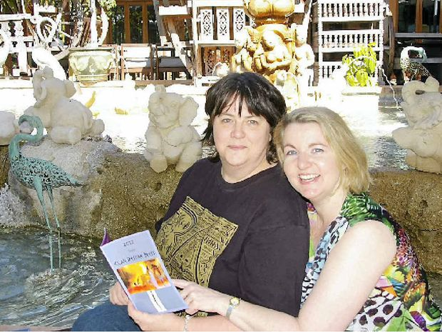 Bundaberg author Cherie Curtis (right) with publisher Lindy Cameron who has offered Mrs Curtis a three-book publishing contract.