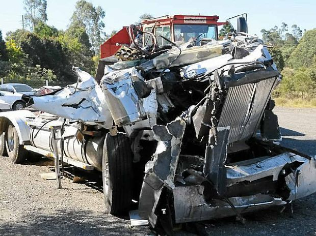 TRAGEDY: The driver of this truck from Hazeldean was killed after his and another B-double collided on the Bruce Hwy's Central Rd overpass at Tinana on August 8.