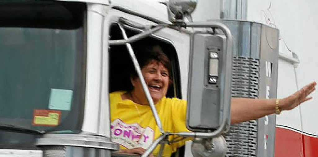 ALL SMILES: A passenger in a truck waves during convoy.